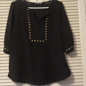 Black top with brass button detail